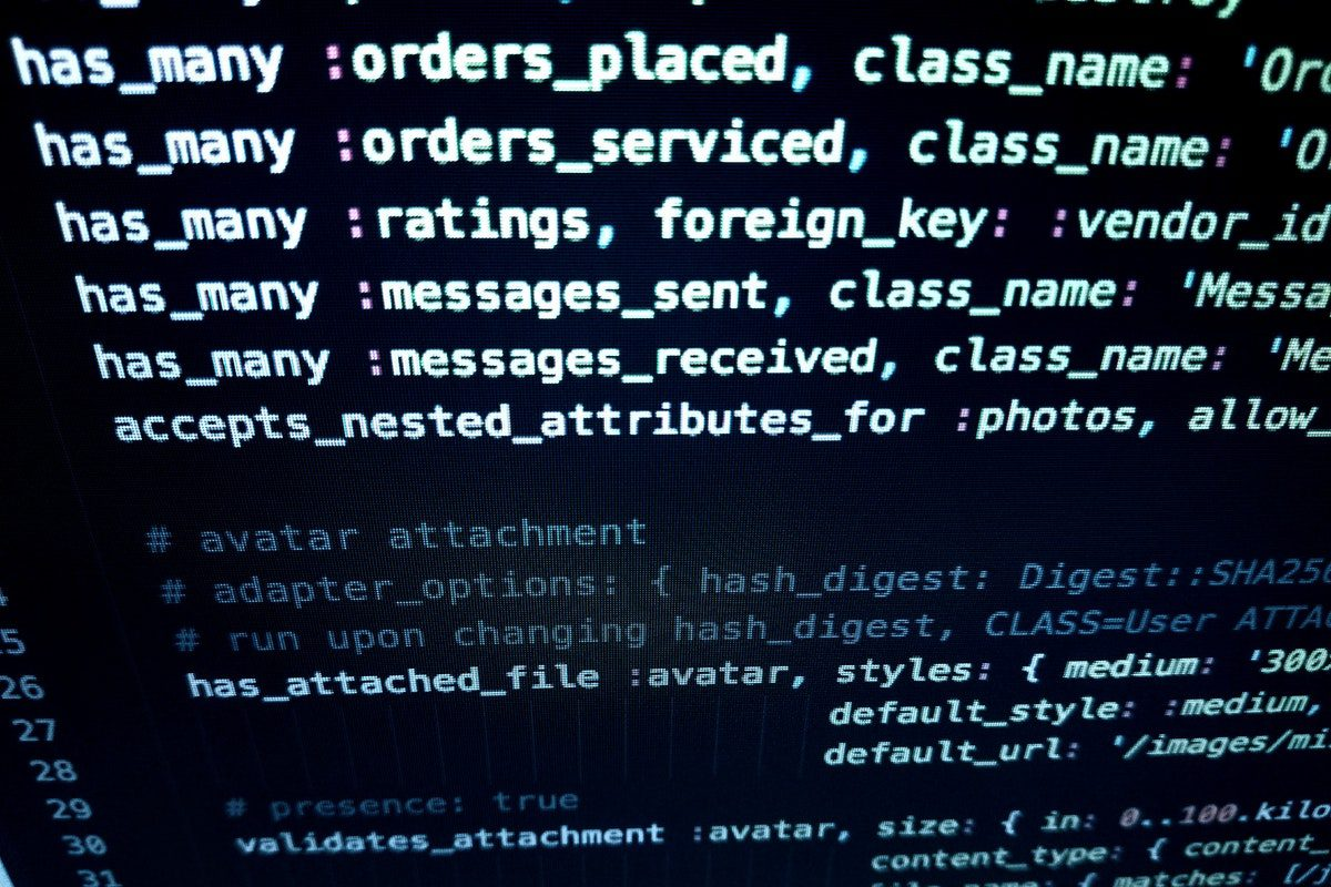 Code displayed on a black screen. How to Become an AWS Developer