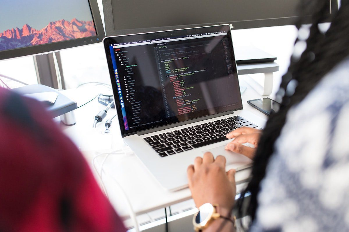 An experienced developer working on a MacBook. How to Become a Salesforce Developer