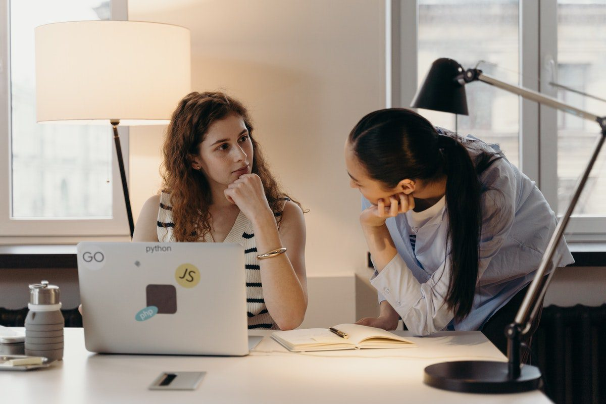 Women talking to each other in an office How to Become a Product Owner