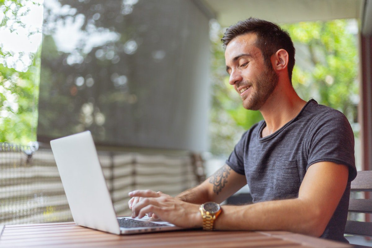 Man using a laptop How to Become a Sales Development Representative