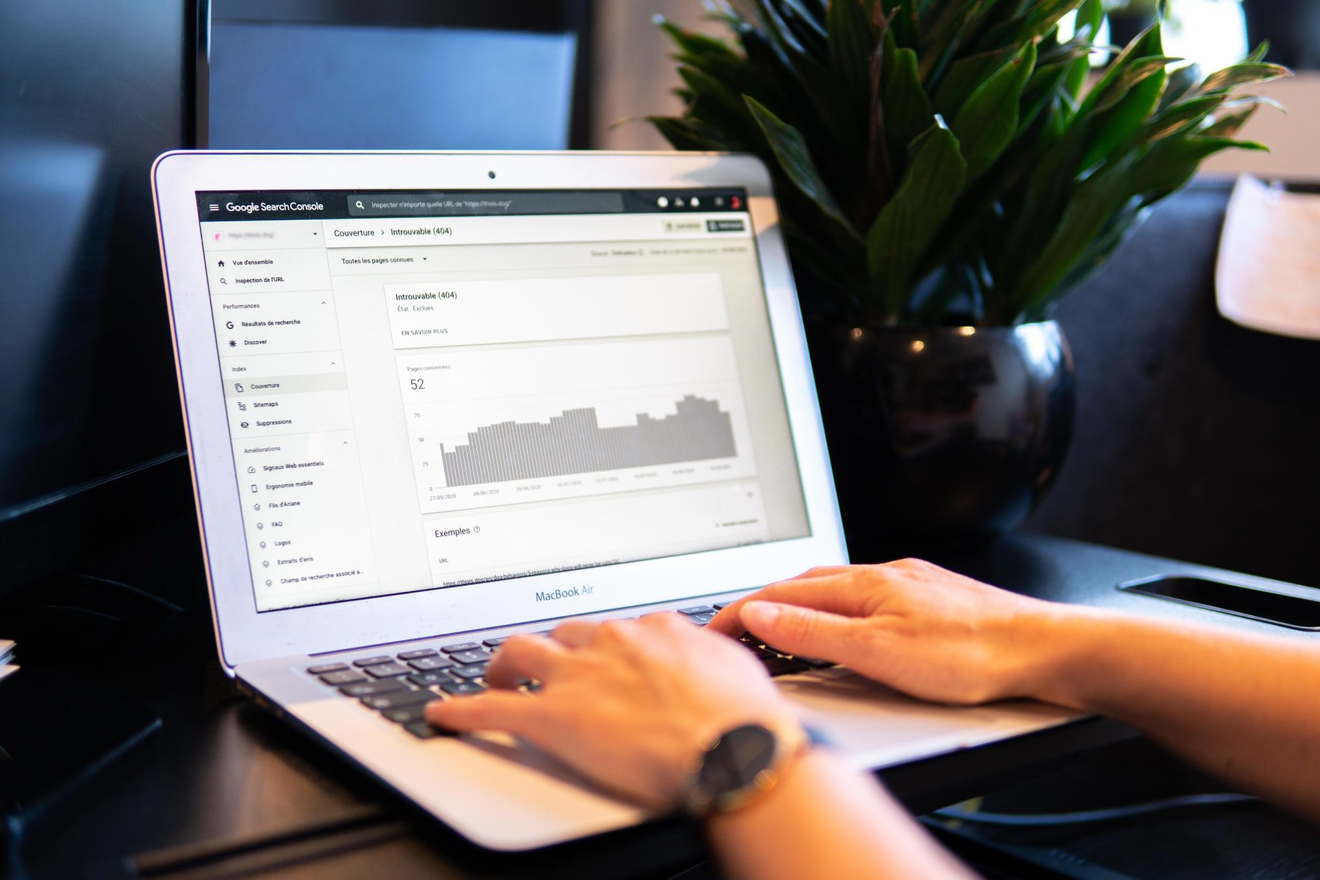 person typing on laptop How To Become An SEO Specialist