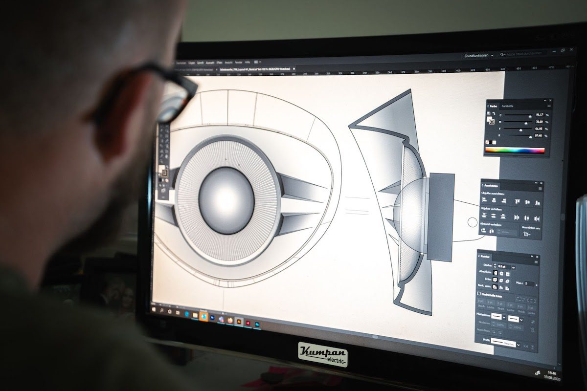 Designer creating design on computer software how to become an industrial designer