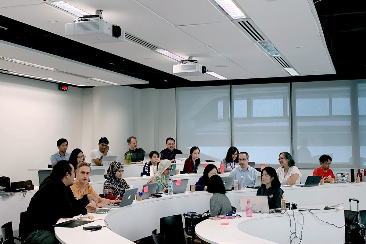 Students using laptops during a class. How to Become a Product Manager