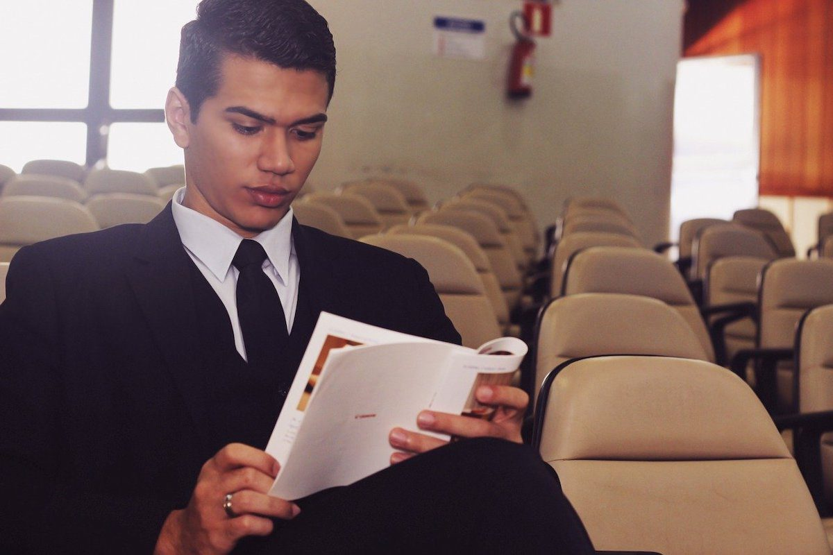 a community college student looking through a schedule of associate degree courses for the upcoming academic term. Network Engineering Associate Degrees