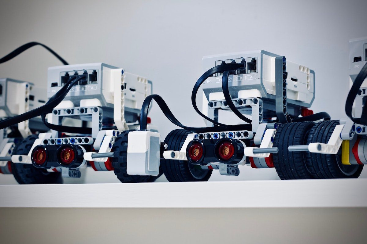 Two black and white electronic robots with wheels. Robotics Bachelor's Degrees