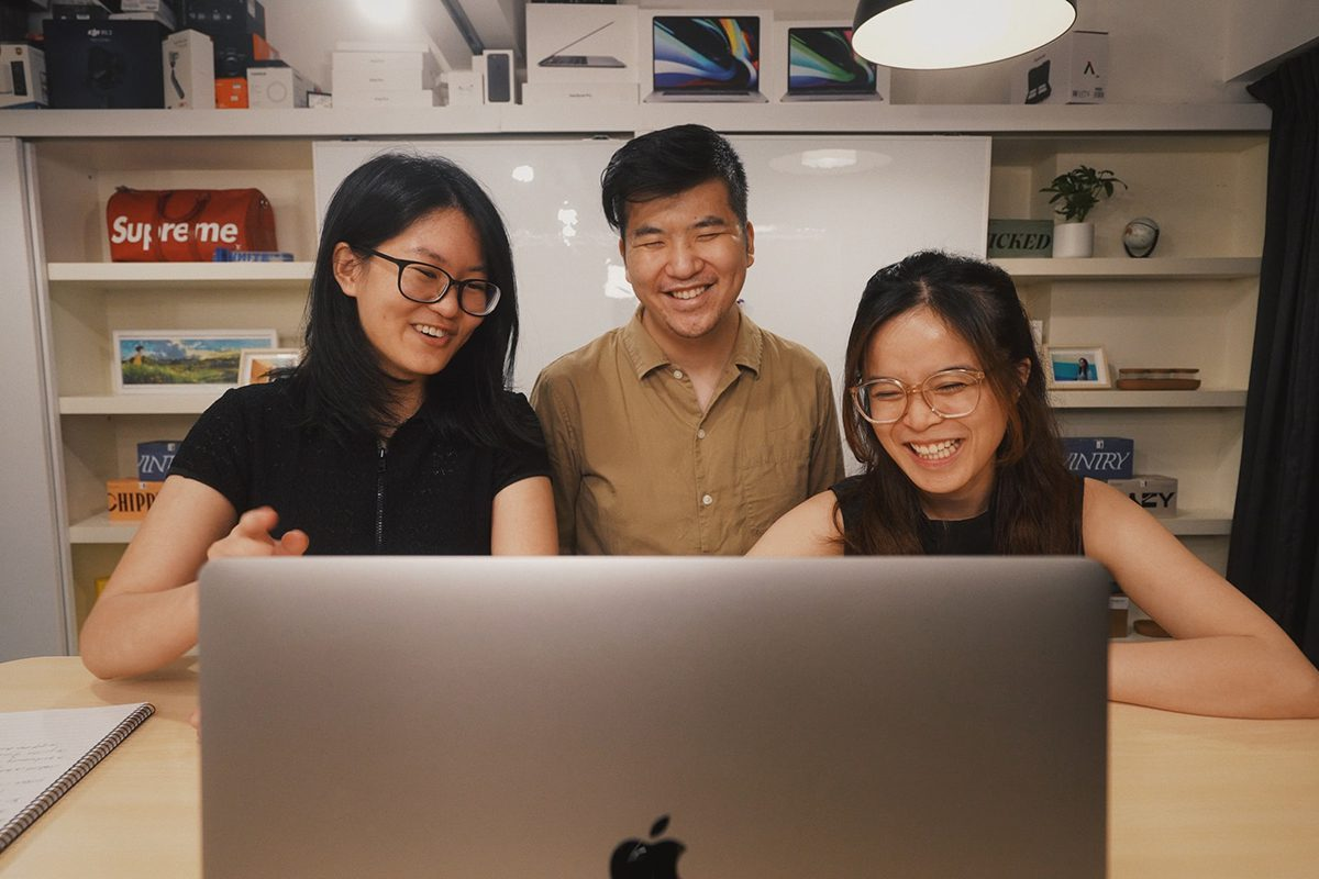 Three people smiling in a job interview. Director of Operations Interview Questions and Answers