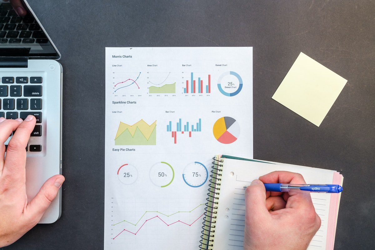 A man evaluating reports, charts, and statistics. Director of Sales Interview Questions and Answers