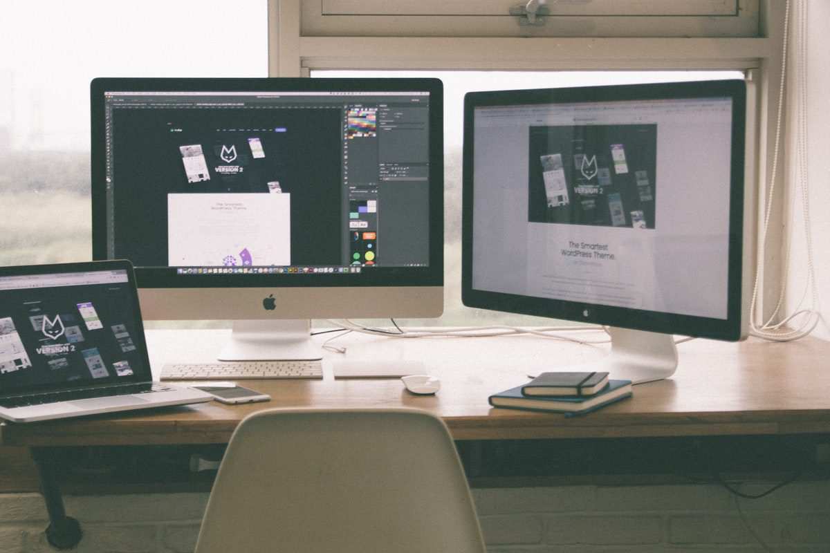 Three screens flash the different processes of web design, including creating elements on Adobe Photoshop and putting them on the website itself. Web Designer Interview Questions and Answers