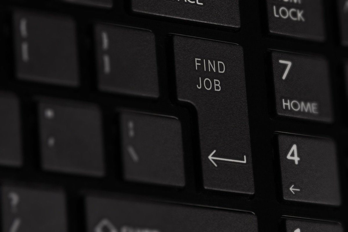 A close-up of the enter key of a computer keyboard. Computer Programming Associate Degrees