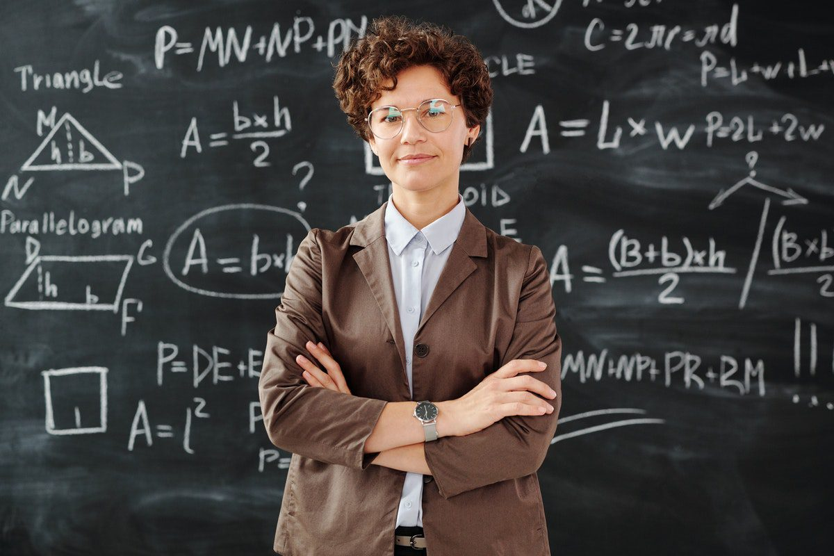 A woman standing in front of a blackboard Jobs for Physics Majors
