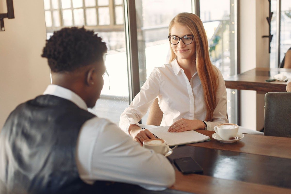 A woman interviewing a man. Account Manager Interview Questions and Answers